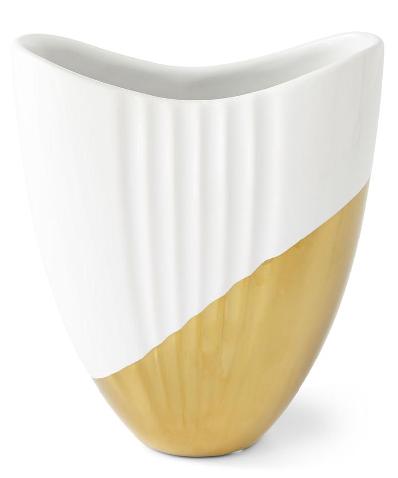 """<p>We're immediately drawn to gold-dipped anything, and these vases are total standouts with their asymmetrical shape and high gloss white finish.</p> <p>$71 
