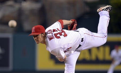 Los Angeles Angels starting pitcher C.J. Wilson throws to the plate during the third inning of their baseball game against the Texas Rangers, Saturday, June 2, 2012, in Anaheim, Calif. (AP Photo/Mark J. Terrill)