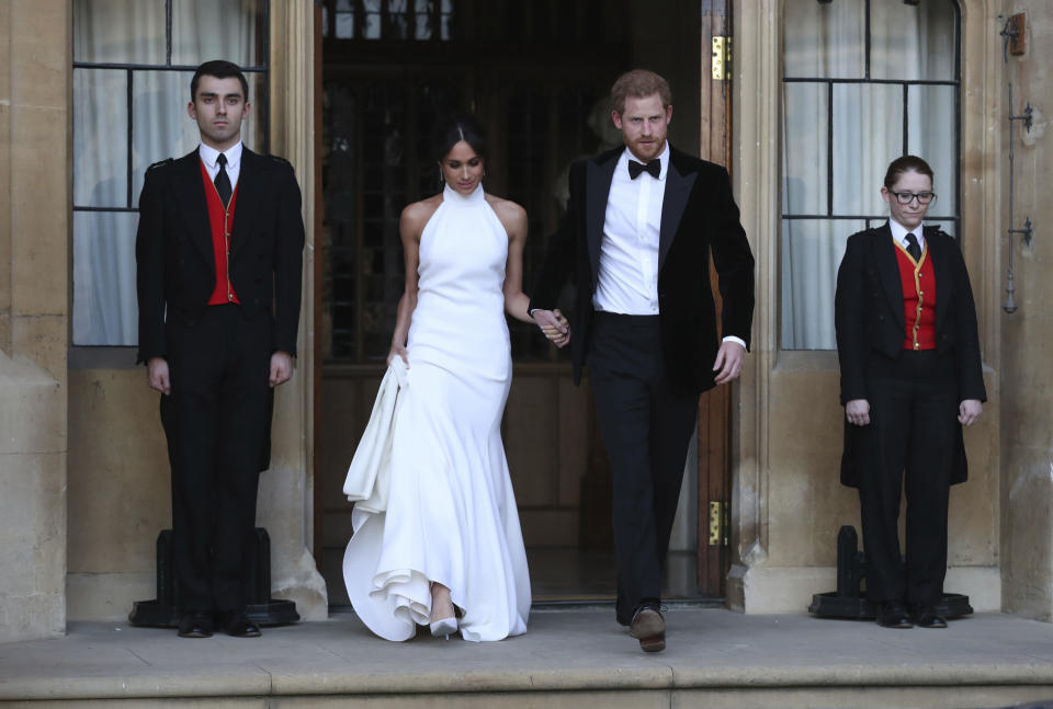 <em>Meghan changed from her Givenchy wedding gown into a glamorous lily white halter neck number by Stella McCartney (Picture: AP)</em>