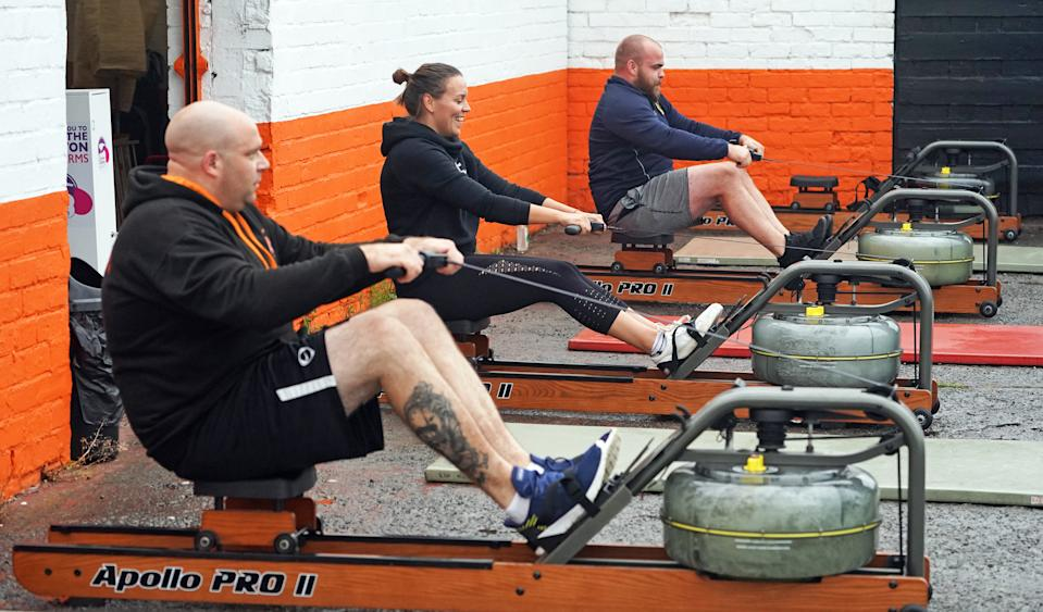 People take part in a small exercise class at the Lionheart Fitness gym in Bedlington, Northumberland, which has moved some equipment into the car park as indoor gyms are still not permitted to open due to coronavirus lockdown restrictions. (Photo by Owen Humphreys/PA Images via Getty Images)