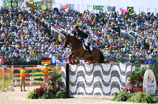 <p>Manuel Fernandez Saro of Spain rides U Watch during the Individual Jumping 3rd Qualifier during Day 12 of the Rio 2016 Olympic Games at the Olympic Equestrian Centre on August 17, 2016 in Rio de Janeiro, Brazil. (Photo by David Ramos/Getty Images) </p>
