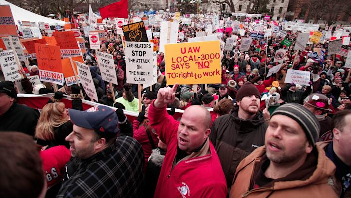 "Union members rally at the Michigan State Capitol in 2012 to protest a vote on right-to-work legislation. The National Right to Work Committee and the American Legislative Exchange Council both promote ""right to work"" model legislation."