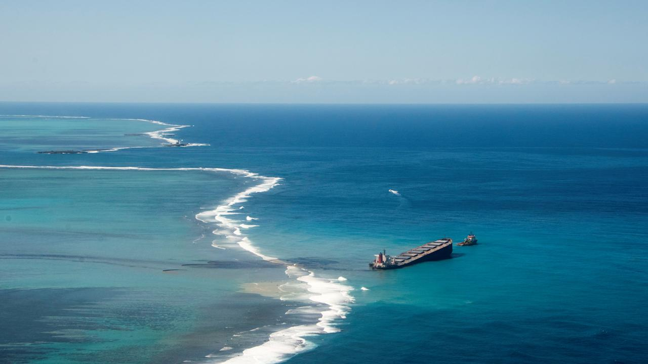 A general view shows the bulk carrier ship MV Wakashio, that ran aground on a reef, at Riviere des Creoles, Mauritius, in this handout image obtained by Reuters on August 11, 2020. French Army command/Handout via REUTERS THIS IMAGE HAS BEEN SUPPLIED BY A THIRD PARTY.     TPX IMAGES OF THE DAY