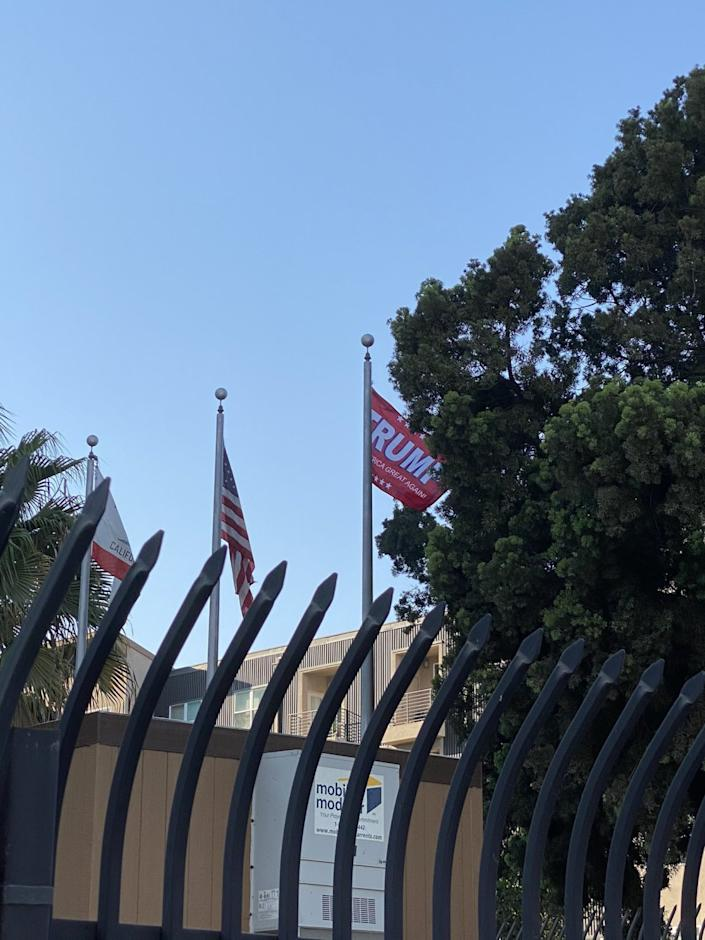 A Long Beach city flag was stolen from outside police headquarters and replaced with a campaign flag for President Trump.