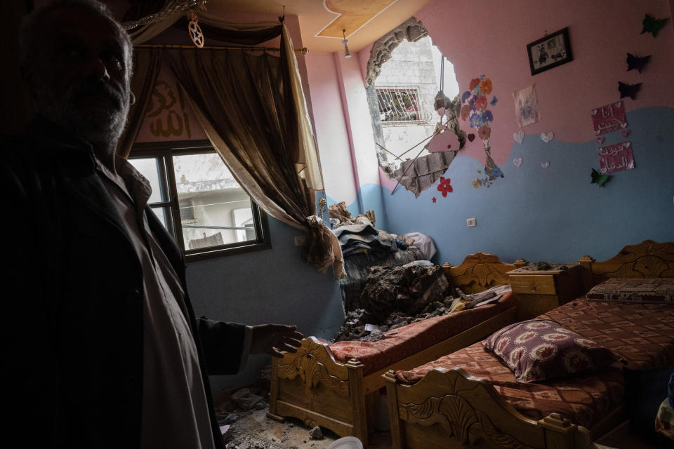A children's room is severely damaged in a building neighboring the home of Ramez al-Masri that was destroyed by an air-strike prior to a cease-fire reached after an 11-day war between Gaza's Hamas rulers and Israel, Sunday, May 23, 2021, in Beit Hanoun, the northern Gaza Strip. (AP Photo/John Minchillo)