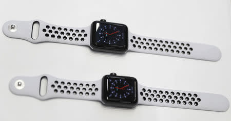 Apple Watches are displayed during a launch event in Cupertino