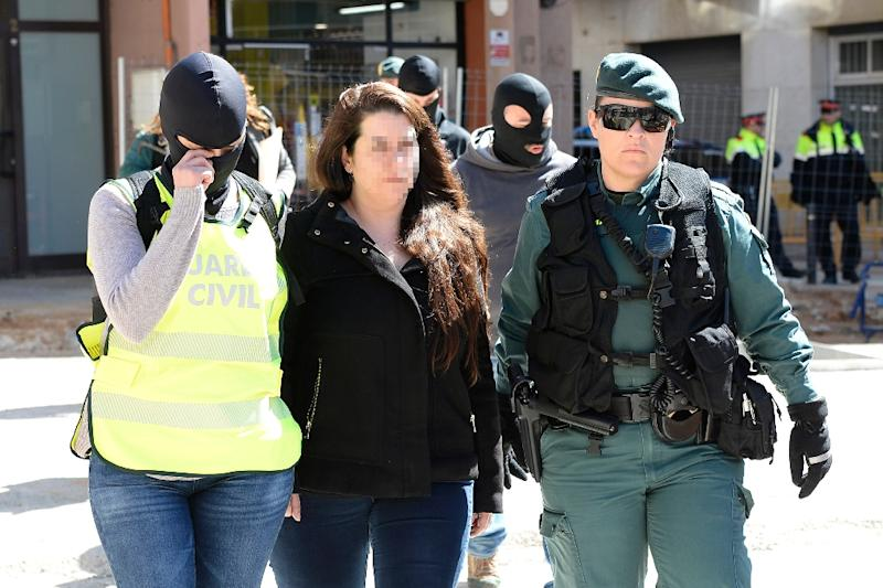 Spain's public prosecutor said an investigation had been opened into two members of a pro-independence pressure group, with one woman arrested