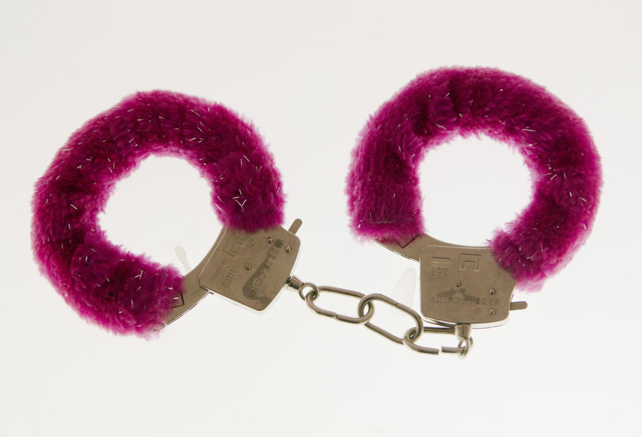 In this photo taken Friday, Feb. 10, 2012, a pair of handcuffs are displayed at the Museum of Broken Relationships in Zagreb, Croatia. The exhibits, collected from all over the world, are random and varied, ranging from fake breasts to a cast from a broken leg. Each item is accompanied by a summary of dates and locations of the relationships, and notes written by their anonymous donors. (AP Photo/Darko Bandic)