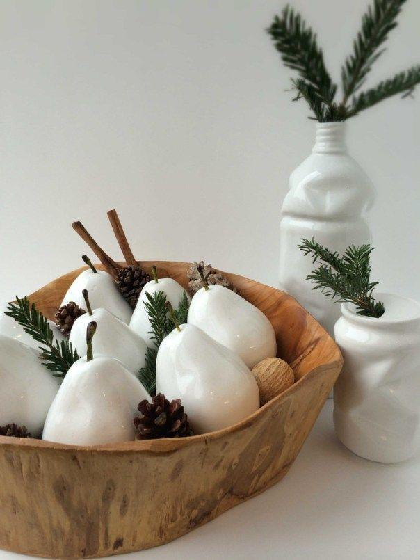 """<p>With evergreen branches and white pears, this centerpiece harnesses the essence of the wintery outdoors when it's too cold to leave the house.</p><p><a class=""""link rapid-noclick-resp"""" href=""""https://www.amazon.com/Gresorth-Artificial-Lifelike-Simulation-Decoration/dp/B00MNBJ2EO?tag=syn-yahoo-20&ascsubtag=%5Bartid%7C10055.g.2196%5Bsrc%7Cyahoo-us"""" rel=""""nofollow noopener"""" target=""""_blank"""" data-ylk=""""slk:SHOP FAUX PEARS"""">SHOP FAUX PEARS</a></p><p><em><a href=""""http://nestingstory.ca/take-season-modern-decorations-dress-holidays/"""" rel=""""nofollow noopener"""" target=""""_blank"""" data-ylk=""""slk:Get the tutorial from Nesting Story »"""" class=""""link rapid-noclick-resp"""">Get the tutorial from Nesting Story »</a></em><br></p>"""