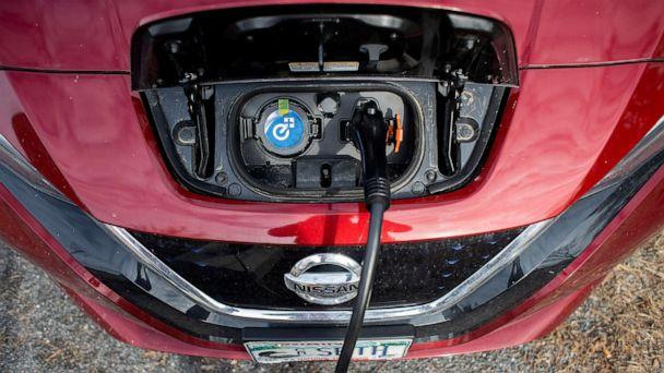 PHOTO: A Nissan Leaf gets charged at a level II EV charging station in Brunswick, Maine, March 9, 2020.  (Portland Press Herald via Getty Images)