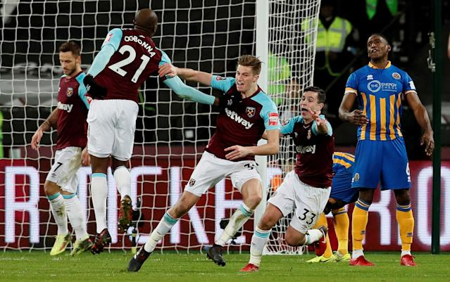 Soccer Football - FA Cup Third Round Replay - West Ham United vs Shrewsbury Town - London Stadium, London, Britain - January 16, 2018 West Ham United's Reece Burke celebrates scoring their first goal with team mates REUTERS/David Klein