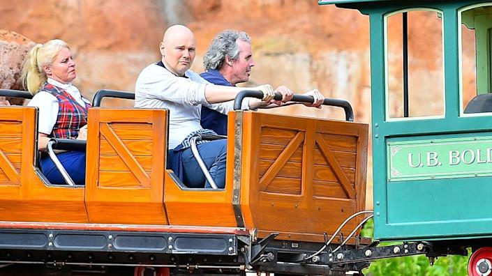 """<p>The Smashing Pumpkins singer did not appear thrilled to ride Big Thunder Mountain at the """"happiest place on earth."""" When this photo went viral, he had a very Billy Corgan response. """"I'm at f***ing Disneyland,"""" he said. """"I just want to hang out at Disneyland. I'm not here to do a meet and greet?"""" Gotta respect where he was coming from. (Photo: Fern/Splash News) </p>"""