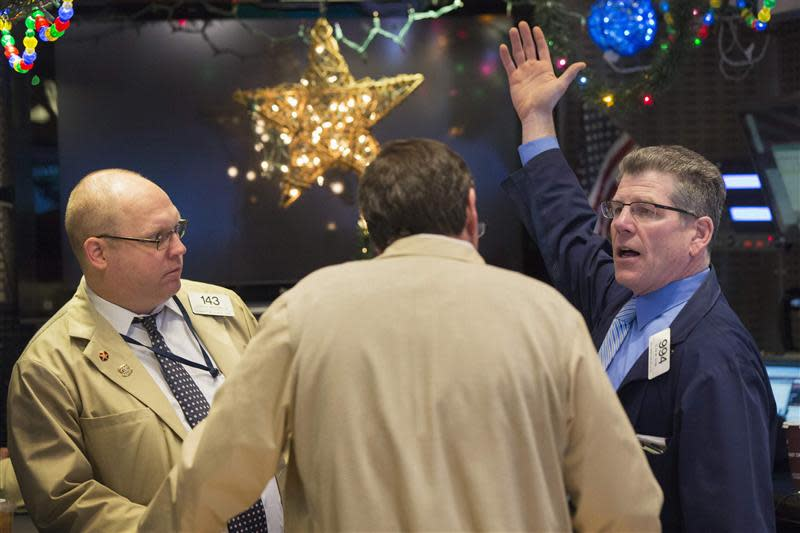 Traders work on the floor of the New York Stock Exchange shortly after the market opening