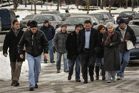 Howard County officials walk to deliver remarks after a shooting at a shopping mall in Columbia, Maryland January 25, 2014. REUTERS/James Lawler Duggan