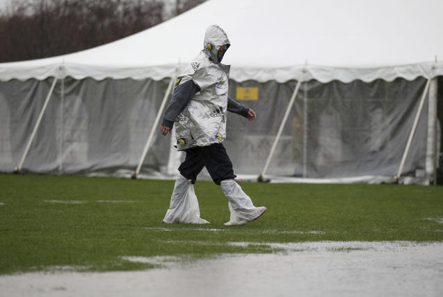 An unidentified runner navigates the flooded athletes village prior to the start of the123rd Boston Marathon on Monday, April 15, 2019, in Hopkinton, Mass. (AP Photo/Stew Milne)