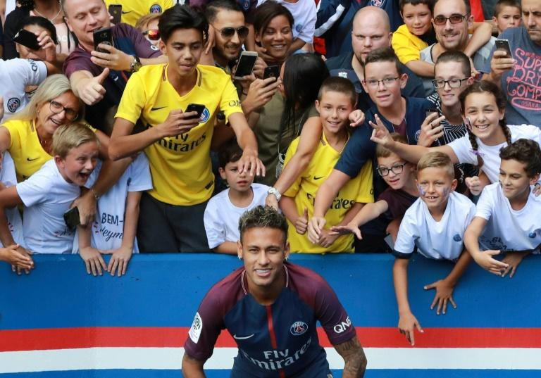 Paris Saint-Germain's new signing Neymar poses for a photo during his presentation to the fans at the Parc des Princes stadium in Paris, on August 5, 2017