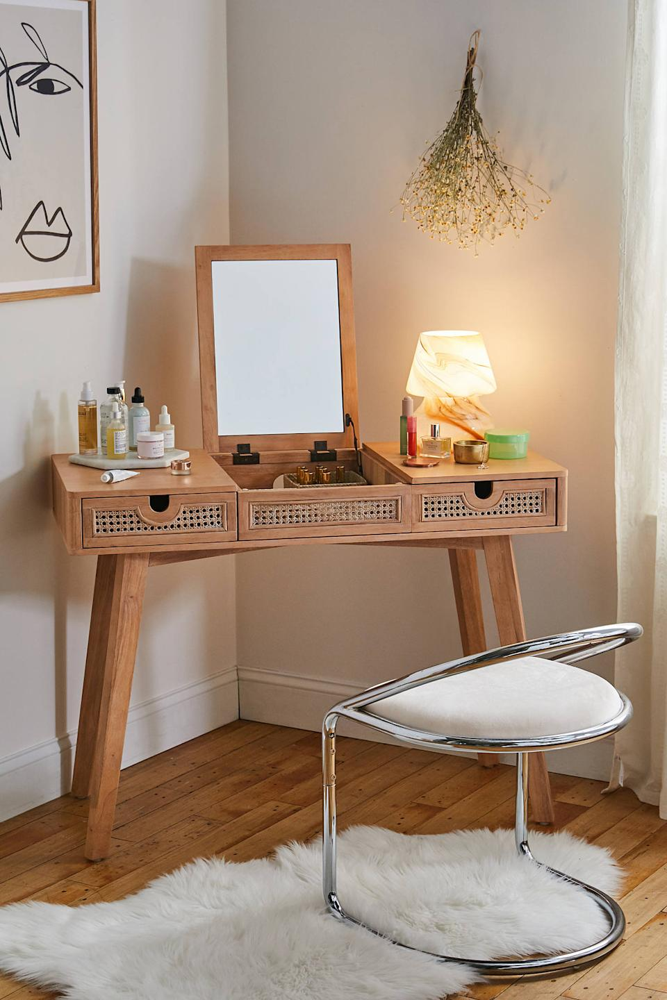 "This boho-chic-style vanity is ready to pop up for your morning beauty-routine needs and fold down to turn itself into a 9-5 workstation star. <br><br><strong><em>Shop <a href=""https://www.urbanoutfitters.com/shop/marte-vanity"" rel=""nofollow noopener"" target=""_blank"" data-ylk=""slk:Urban Outfitters"" class=""link rapid-noclick-resp"">Urban Outfitters</a></em></strong> <br><br><strong>Urban Outfitters</strong> Marte Vanity, $, available at <a href=""https://go.skimresources.com/?id=30283X879131&url=https%3A%2F%2Fwww.urbanoutfitters.com%2Fshop%2Fmarte-vanity"" rel=""nofollow noopener"" target=""_blank"" data-ylk=""slk:Urban Outfitters"" class=""link rapid-noclick-resp"">Urban Outfitters</a>"