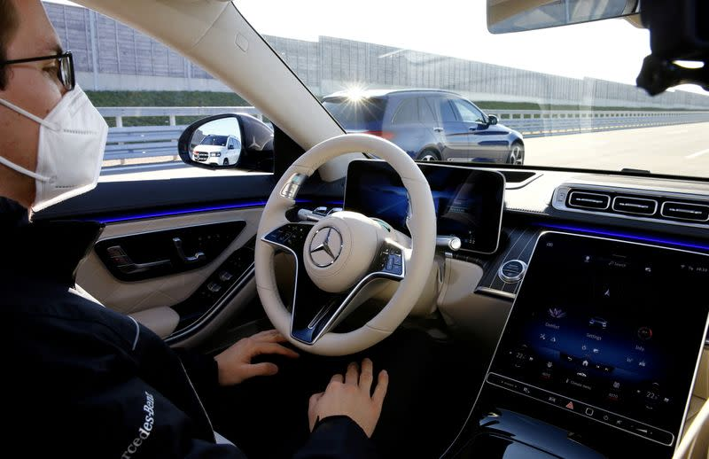 FILE PHOTO: An employee demonstrates steering by autonomous driving system in a new Mercedes-Benz S-Class limousine near Immendingen