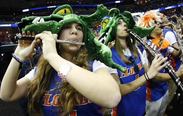 The Florida pep band performs before the first half in a regional final game against Dayton at the NCAA college basketball tournament, Saturday, March 29, 2014, in Memphis, Tenn. (AP Photo/John Bazemore)