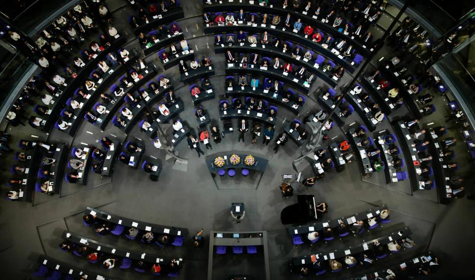File - In this Thursday, Jan. 17, 2019 file photo German lawmakers attend a special parliament session at the Reichstag building, host of the German federal parliament, Bundestag, in Berlin, Germany, to celebrate 100 years of women's suffrage in Germany. Hundreds of immigrants are running in Germany's national election on Sunday, raising the possibility of making its next parliament more diverse than ever. While it still might not fully represent the country's overall diversity, where more than a quarter of the population has immigrant roots, it's a step toward a more accurate reflection of society. (AP Photo/Markus Schreiber,File)