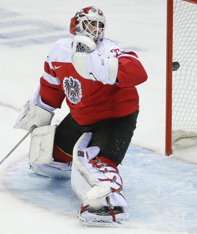 Austria goaltender Bernhard Starkbaum looks back as the puck hits the net for a goal by Finland in the first period of a men's ice hockey game at the 2014 Winter Olympics, Thursday, Feb. 13, 2014, in Sochi, Russia. (AP Photo/Mark Humphrey)