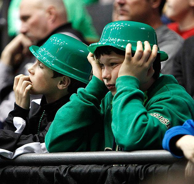 Young Notre Dame fans lament the Irish's loss to Iowa State on Friday. (Getty)