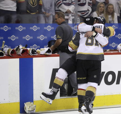 Vegas Golden Knights' Erik Haula (56) and Jonathan Marchessault (81) celebrate after defeating the Winnipeg Jets during NHL Western Conference Finals, game 5, in Winnipeg, Sunday, May 20, 2018. (Trevor Hagan/The Canadian Press via AP)