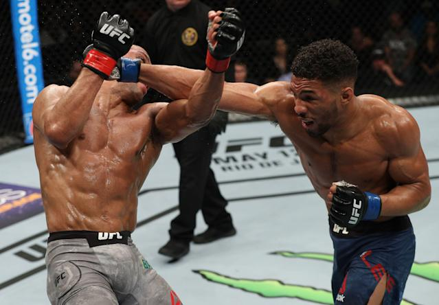 Kevin Lee punches Edson Barboza in their lightweight fight during UFC Fight Night at the Boardwalk Hall on April 21, 2018 in Atlantic City, New Jersey. (Getty Images)