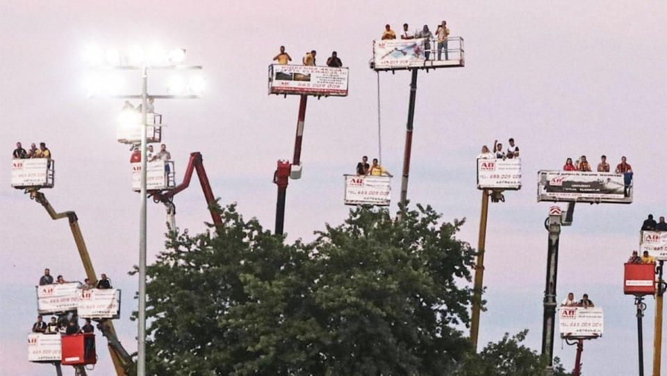 Fans of Motor Lublin race team renting cranes to watch their team.