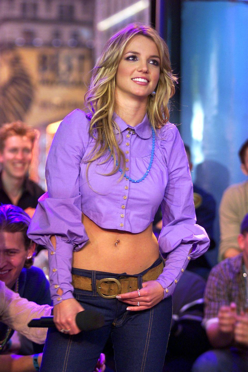 <p>#TBT to the good ol' days of <em>TRL</em> and this amazing cropped purple button-up with dramatic puff sleeves. Love the contrast of the beaded necklace and the super-low-rise, dark-wash jeans, right? </p>