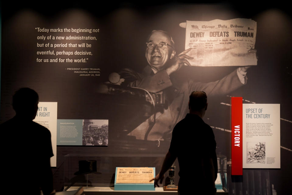 People view an exhibit about the 1948 presidential election during a tour of the Harry S. Truman Presidential Library and Museum Wednesday, June 9, 2021, in Independence, Mo. The facility will reopen July 2 after a nearly $30 million renovation project. (AP Photo/Charlie Riedel)