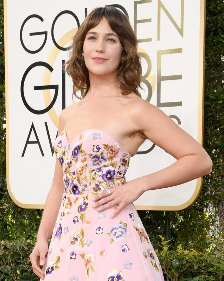 Lola Kirke with underarm hair on the red carpet