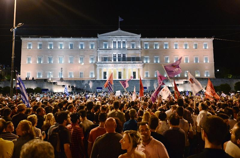 People celebrate in Athens on July 5, 2015 after the first exit-polls of the Greek referendum (AFP Photo/Louisa Gouliamaki)