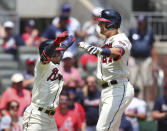 Atlanta Braves' Austin Riley, right, celebrates after hitting his second home run with teammate Ozzie Albies, left, during the third inning of a baseball game against the Pittsburgh Pirates, Sunday, May 23, 2021, in Atlanta. (Curtis Compton/Atlanta Journal-Constitution via AP)