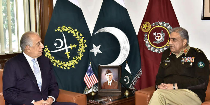 In this photo released by Inter Services Public Relations of Pakistan's military, U.S. peace envoy Zalmay Khalilzad, left, talks with Pakistani Army Chief Gen. Qamar Javed Bajwa during a meeting in Rawalpindi, Pakistan, Friday, Jan. 31, 2020. During the meeting, matters of mutual interest including overall regional security situation and ongoing Afghanistan Reconciliation Process were discussed, official said.(Inter Services Public Relations via AP)