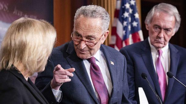 PHOTO: Senate Minority Leader Chuck Schumer points to Democratic Presidential Candidate Senator Kirsten Gillibrand during a press conference on the Senate impeachment trial of President Donald Trump, Jan, 24, 2020 in Washington, D.C. (Samuel Corum/Getty Images)