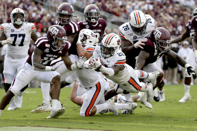 Auburn running back JaTarvious Whitlow (28) dives over the goal line for a touchdown against Texas A&M during the second half of an NCAA college football game, Saturday, Sept. 21, 2019, in College Station, Texas. (AP Photo/Sam Craft)