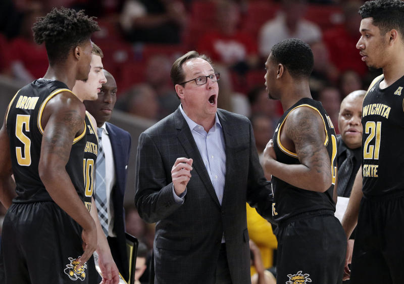 Wichita State head coach Gregg Marshall, center, talks with his players at a time out during the first half of an NCAA college basketball game against Houston, Saturday, Jan. 12, 2019, in Houston. (AP Photo/Michael Wyke)