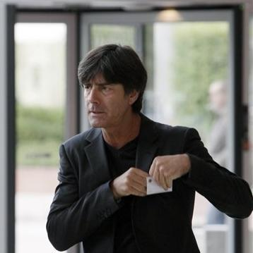 German head coach Joachim Loew arrives for the opening session of 10th UEFA Conference for European national soccer team coaches from some 50 European nations at the start of their two-day meeting in Warsaw, Poland, on Monday, Sept. 24, 2012. Poland co-hosted the EURO 2012 football championship in June. (AP Photo/Czarek Sokolowski)