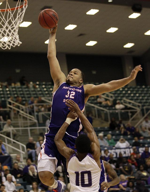 Northwestern State'a DeQuan Hicks (32) drives to the basket over Stephen F. Austin's Trey Pinkney (10) during the first half of an NCAA college basketball game in the semifinal round of the Southland Conference tournament Friday, March 14, 2014, in Katy. (AP Photo/Bob Levey)