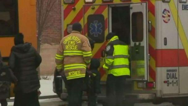 PHOTO: Paramedics assess a child after his bus, driven by Lisa Byrd rolled through an intersection and into a tree after she overdosed in Newark, N.J., on Wednesday, Feb. 21, 2019. (WABC)