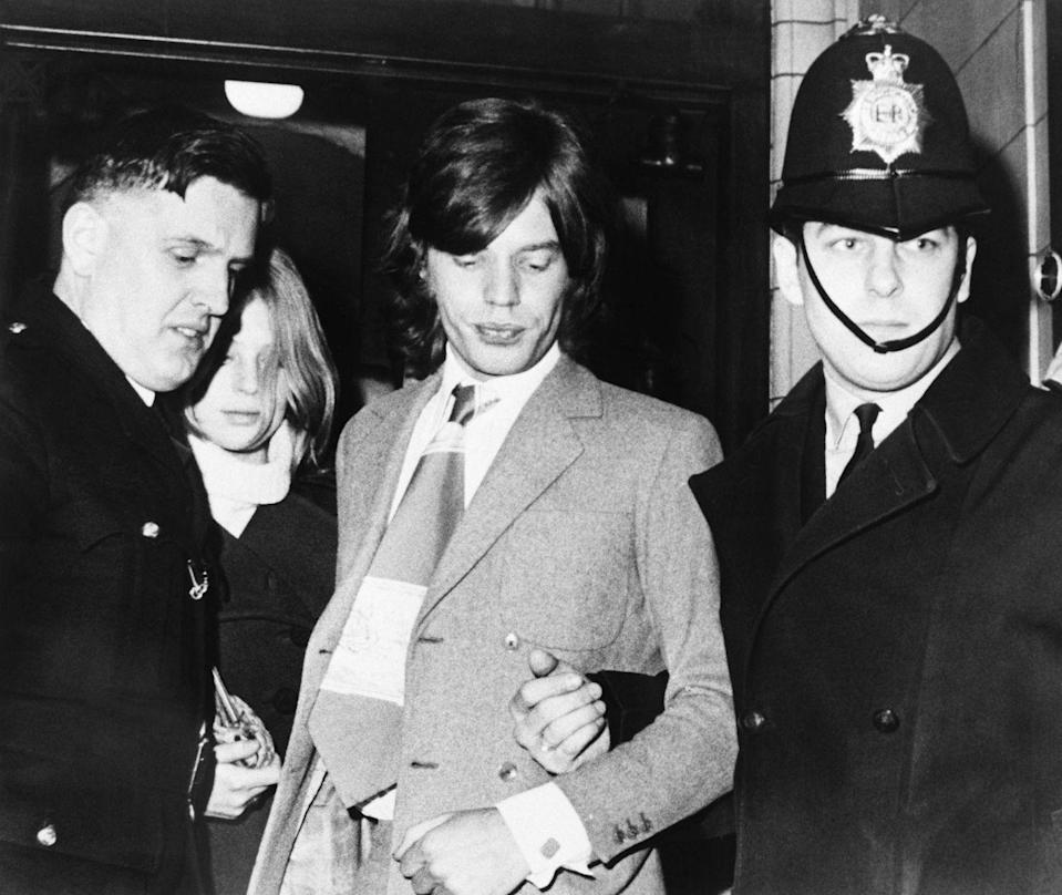 <p>Policemen escort Rolling Stones lead performer Mick Jagger and his former girlfriend, Marianne Faithfull from court Jan. 26 after they were fined $480 for possession of marijuana in 1970.</p>