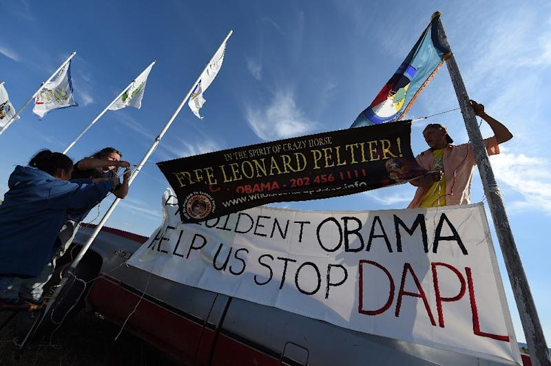 Protestors hang signs against the Dakota Access Pipeline, at the protest camp near Cannon Ball, North Dakota, on September 3, 2016 (AFP Photo/Robyn Beck)