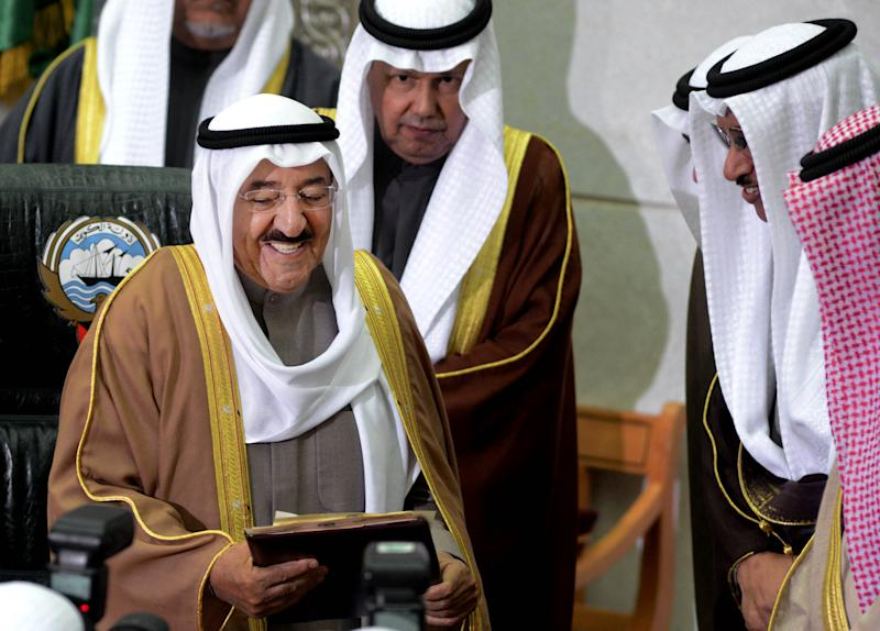 "The Amir of Kuwait, Sheikh Sabah Al Sabah, left, receives a copy of a speech given by Kuwait's Prime Minister, Sheikh Jaber al-Mubarak al-Sabah, second right, during the inauguration of the 14th Legislative Term of the National Assembly in Kuwait, Sunda,  Dec 16, 2012. Security forces blocked hundreds of protesters from staging a rally outside the parliament building Sunday, as Kuwait's amir denounced anti-government factions as committing ""treason"" and vowed to stand firm amid the country's deepening political crisis. (AP Photo/Gustavo Ferrari)"