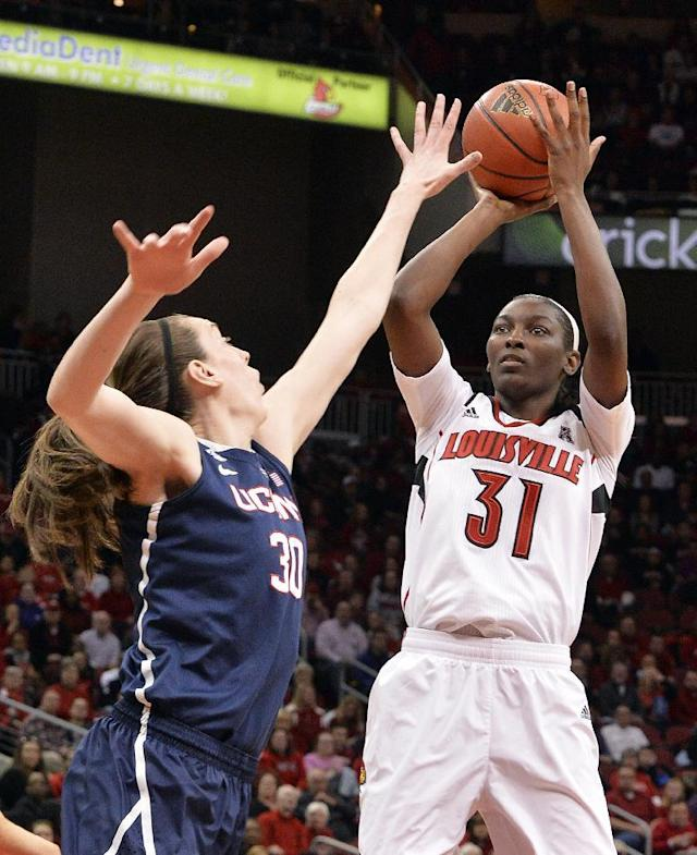 Louisville's Asia Taylor, right, puts up a shot over the defense of Connecticut's Breanna Stewart during the first half of an NCAA college basketball game, Monday, March 3, 2014, in Louisville, Ky. (AP Photo/Timothy D. Easley)