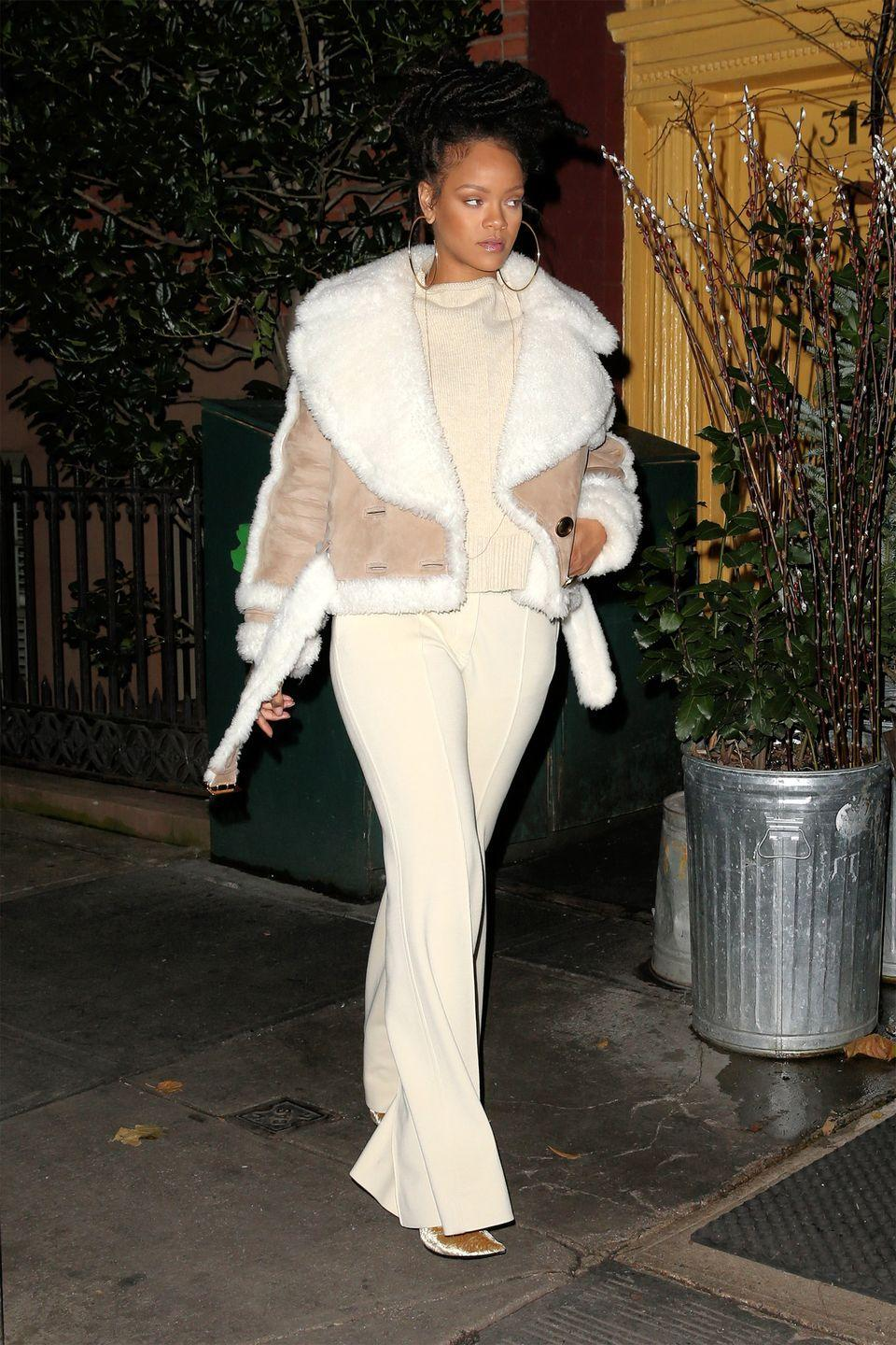 <p>In a cropped Burberry shearling coat, cream sweater, matching flared pants, gold velvet pumps and hoop earrings while out in New York. </p>