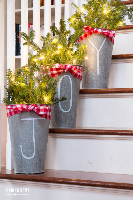 "<p>Stuff galvanized flower buckets with fresh pine, draw on a festive message, and light it all up with twinkly lights!</p><p>Get the tutorial at <a href=""http://findinghomefarms.com/10-minute-christmas-decorating-idea-chalk-pen-galvanized-buckets/"" rel=""nofollow noopener"" target=""_blank"" data-ylk=""slk:Finding Home Farms"" class=""link rapid-noclick-resp"">Finding Home Farms</a>.</p>"