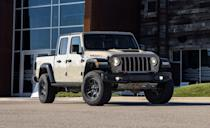 "<p>Back to battle golden bow ties and blue ovals in the mid-size-truck coliseum for 2019 after a long absence, the<a href=""https://www.caranddriver.com/jeep/gladiator"" rel=""nofollow noopener"" target=""_blank"" data-ylk=""slk:Jeep Gladiator"" class=""link rapid-noclick-resp""> Jeep Gladiator</a> is Stellantis' modern take on a Jeep turned truck. Taking design cues from its smaller sibling the <a href=""https://www.caranddriver.com/jeep/wrangler"" rel=""nofollow noopener"" target=""_blank"" data-ylk=""slk:Wrangler"" class=""link rapid-noclick-resp"">Wrangler</a>, the Gladiator's interior offers luxury unmatched by anything else you'd drive without doors. Unfortunately, only one cab and one bed length are available. A 280-hp 3.6-liter V-6 with a six-speed manual transmission is standard. There's also a 260-hp diesel with 442 lb-ft of torque that makes the Gladiator the most fuel-efficient pickup on the list with an EPA-estimated 27 mpg highway. The Jeep's high starting price make it the most expensive, even more than most base full-size pickups. <a class=""link rapid-noclick-resp"" href=""https://www.caranddriver.com/jeep/gladiator/specs"" rel=""nofollow noopener"" target=""_blank"" data-ylk=""slk:MORE JEEP GLADIATOR SPECS"">MORE JEEP GLADIATOR SPECS</a></p><ul><li>Base price: $35,060</li><li>Powertrain: 260-hp 3.0L turbo-diesel, eight-speed automatic transmission; 285-hp 3.6-liter V-6, six-speed manual transmission, eight-speed automatic transmission</li><li>Max Towing: 7650 lb</li></ul>"