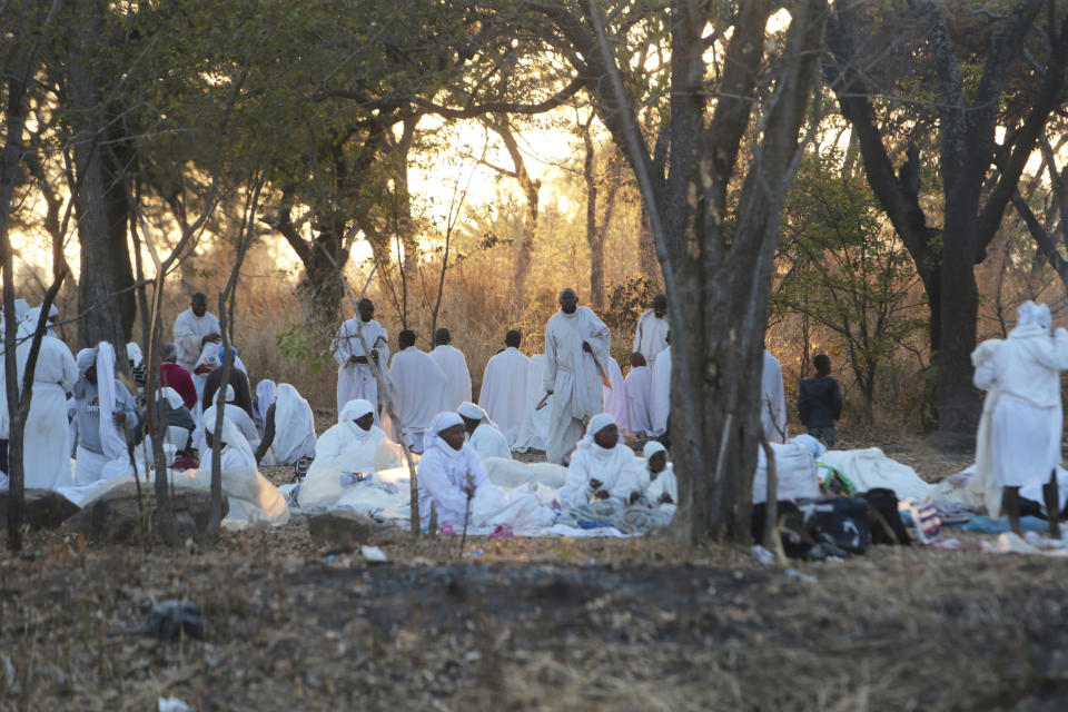 Members of the Apostolic church gather for a morning prayer in Harare, Friday, Aug, 20, 2021. The Zimbabwean government has given the green light for churches to reopen for fully vaccinated congregants accoring to a statement issued by the Ministry of Information. (AP Photo/Tsvangirayi Mukwazhi)