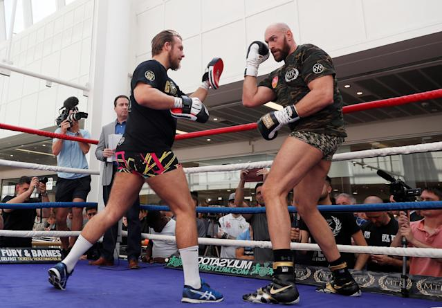 Tyson Fury and trainer Ben Davison (L) during a work out in front of media on Aug. 15, 2018. (Reuters)